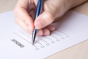 Writing down a checklist for moving