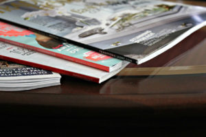 Magazines stacked on table